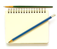 Notebook, paintbrush, pencil. Notebook, paintbrush, pencil on a white background Stock Photography