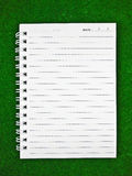 Notebook Paper. On green background stock photos