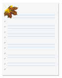 Notebook paper with autumn maple leaf in corner Stock Images
