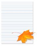Notebook paper with autumn maple leaf on white Royalty Free Stock Image
