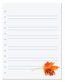 Notebook paper with autumn orange maple leaf on white Stock Photo