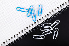 Notebook and paper clips close-up on Stock Photography