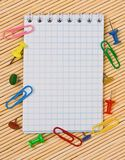 Notebook, paper clips, hairpins Stock Photos