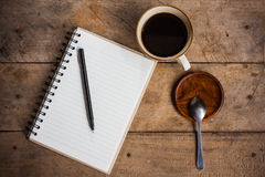 Notebook paper and coffee Stock Photos