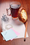 Notebook paper and a cup of tea Royalty Free Stock Photography