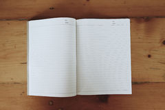 Notebook paper on desk royalty free stock images