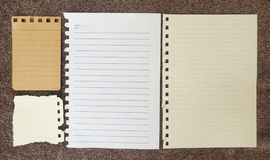 Notebook paper on fabric. Royalty Free Stock Photos
