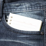 Notebook paper in jean pocket Stock Photography