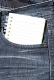 Notebook paper in jean pocket Royalty Free Stock Photo