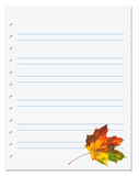 Notebook paper with multicolor autumn maple leaf on white Royalty Free Stock Images