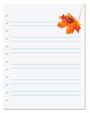 Notebook paper with orange autumn maple leaf on white Stock Photography