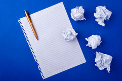 Notebook paper and pen Royalty Free Stock Images