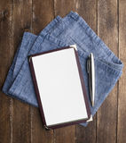 Notebook paper with pen on wooden table Royalty Free Stock Photography