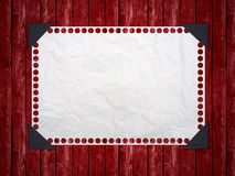 Notebook paper on red background. Royalty Free Stock Image
