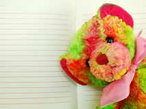 Notebook paper with red lines and colorful teddy bear Stock Photos