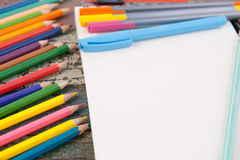 Notebook paper and school or office tools on vintage wood table Stock Photos