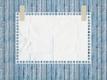 Notebook paper. Tattered lined white page. Notebook paper. Tattered lined white page pasted to a wooden, vintage background Royalty Free Stock Photography