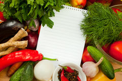 Notebook paper to write recipes and vegetables Royalty Free Stock Photos