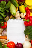 Notebook paper to write recipes and vegetables Royalty Free Stock Images