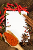 Notebook paper with various spices Stock Photo
