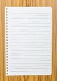 Notebook paper on wood . Notebook paper on wood background Stock Image