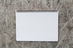 Notebook paper on wood background Stock Photos