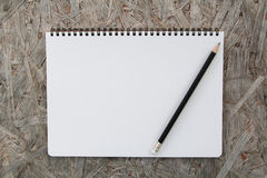 Notebook paper on wood background Royalty Free Stock Image