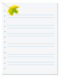 Notebook paper with yellow autumn maple leaf on white Royalty Free Stock Photography