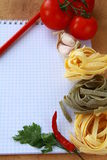 Notebook with  pasta  and vegetables for a menu Royalty Free Stock Photos