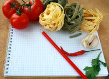 Notebook with  pasta  and vegetables for a menu Royalty Free Stock Photography