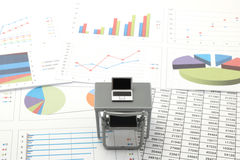 Notebook PC and business documents with numbers and charts. Stock Images