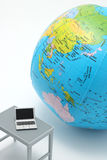 Notebook PC and globe on white background. Royalty Free Stock Images