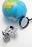 Notebook PC, magnifying glass and globe on white background. Stock Photos