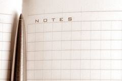 Notebook with a pen Stock Photography