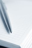 Notebook with a pen. Open notebook with a pen royalty free stock photography