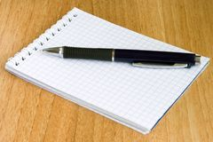 Notebook and pen. Laying on a table Stock Images