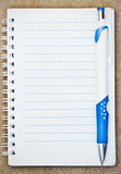 Notebook with pen. Notebook with a blue pen Royalty Free Stock Images