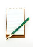 Notebook and pen. Notepad with pen on lower right corner isolated on white Royalty Free Stock Photography