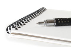 Notebook with pen. Isolated on white Stock Photos
