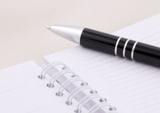 Notebook and pen Royalty Free Stock Images