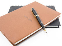 Notebook with pen. On white stock photo
