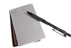 Notebook and Pen. A small sprial notebook and pen with to do list Stock Photo