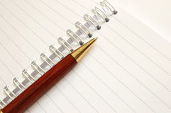 Notebook with a pen. Blank notepaper with a pen stock photography