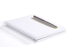 Notebook & pen. On a white background Royalty Free Stock Photos