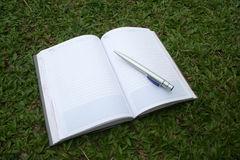 Notebook & pen. On the field stock image