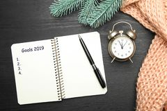 Notebook with pen and alarm clock royalty free stock image