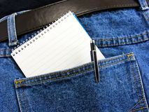 A notebook & pen in back pocket Stock Images