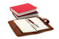 Notebook, pen and books Royalty Free Stock Photography