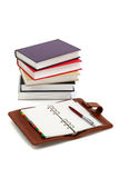 Notebook, pen and books Stock Photos
