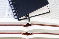 Notebook and Pen on Books Stock Photo